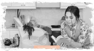 woman reading recipe and nutrition book